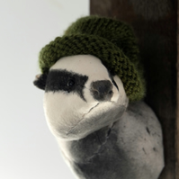 Textile badger with hand knitted beanie whisky barrel. Upcycled fibre animal art