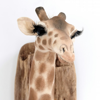 Textile taxidermy giraffe wall sculpture. Vegetarian trophy, fauxidermy animal.
