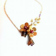Brass leaves and flower cluster necklace
