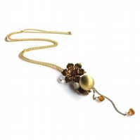 Vintage locket necklace with brass flower