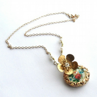 Brass flower and vintage floral cabochon necklace.