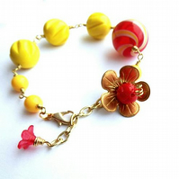 Vintage bead bracelet with brass flower charm