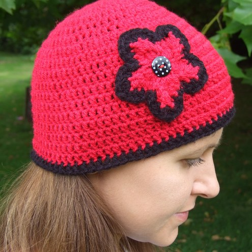 Red crochet hat with flower on the side