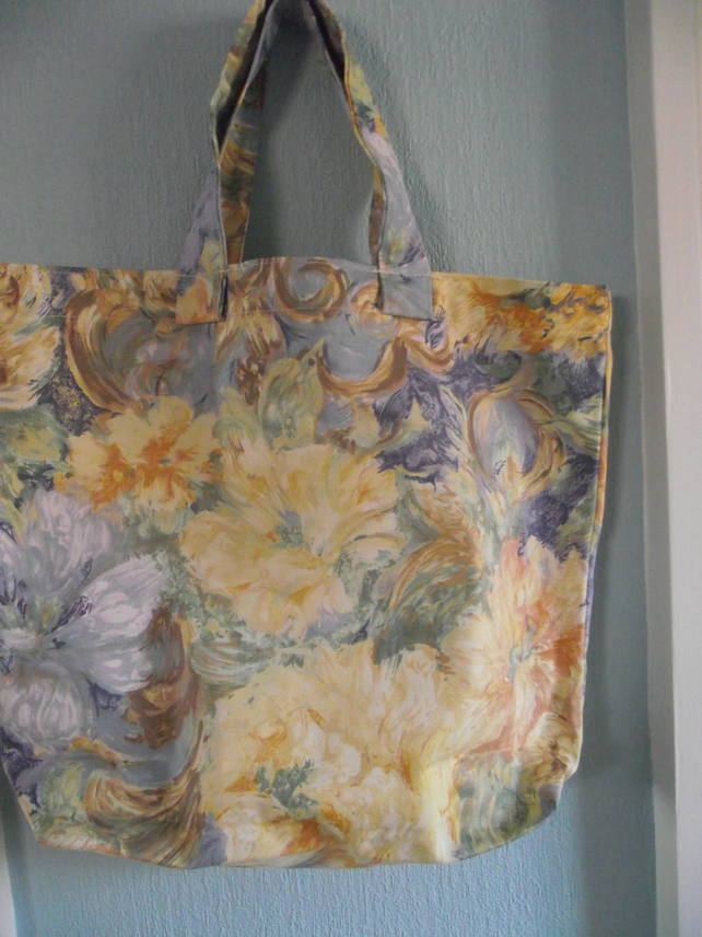 blue and yellow flowered shopping bag