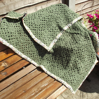 green hand crocheted blanket