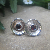 Small silver studs with garnet