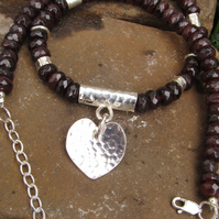 Silver battered heart pendant with faceted garnets
