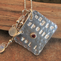 'Magic Spells. Vol. 1' Sterling silver Booklet with Garnet and Moonstone