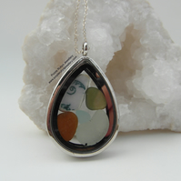 Beach Treasures Teardrop Locket filled with Cornish Pottery Swirl and Sea Glass
