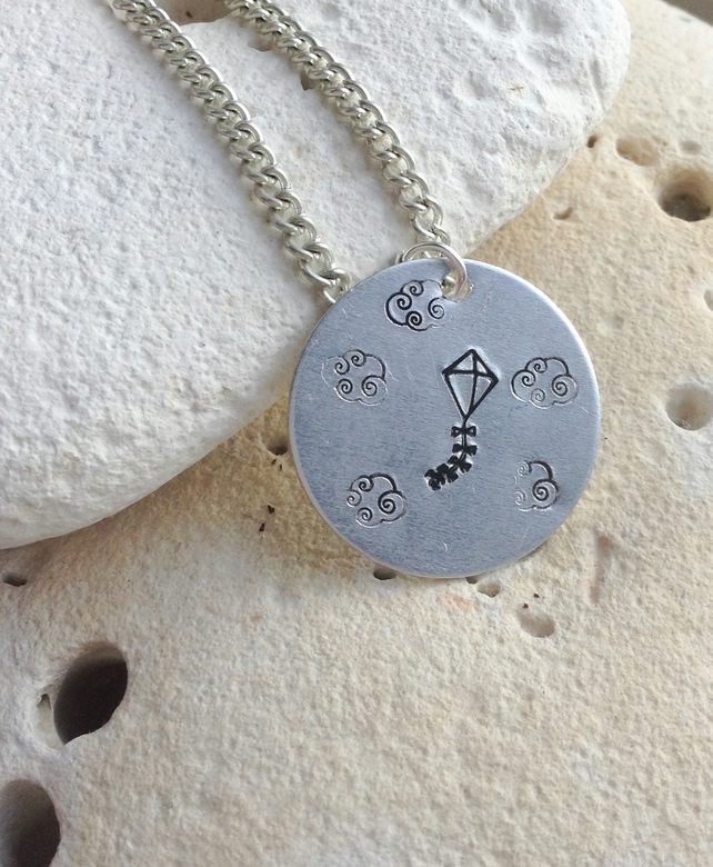 Gorgeous shabby chic inspired handstamped pendant with kite and clouds