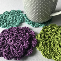Vibrant peacock inspired crocheted coasters
