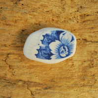 Sea pottery brooch with flower