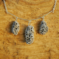 Holey beach pebble necklace