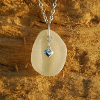White sea glass pendant with sterling silver heart