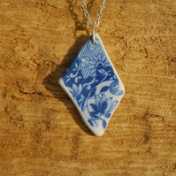 Beach pottery pendant with blue flowers