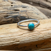 Sterling silver ring with turquoise cabochon