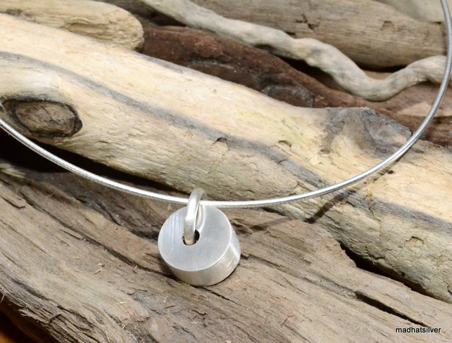 Pendant with brushed silver cylindrical bead