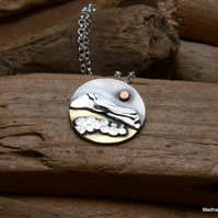 Silver, and brass scenic beach pendant