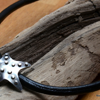 Silver starfish pendant on thick leather cord