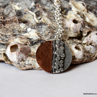 Silver and copper pebble pendant