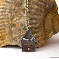 Silver, and copper beach hut or house pendant