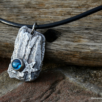 Silver cast 'driftwood' pendant with silver starfish and paua shell