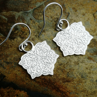 Patterned earrings.