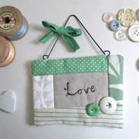 'Love' Hanging Quilted Fabric Quote with Button Decoration