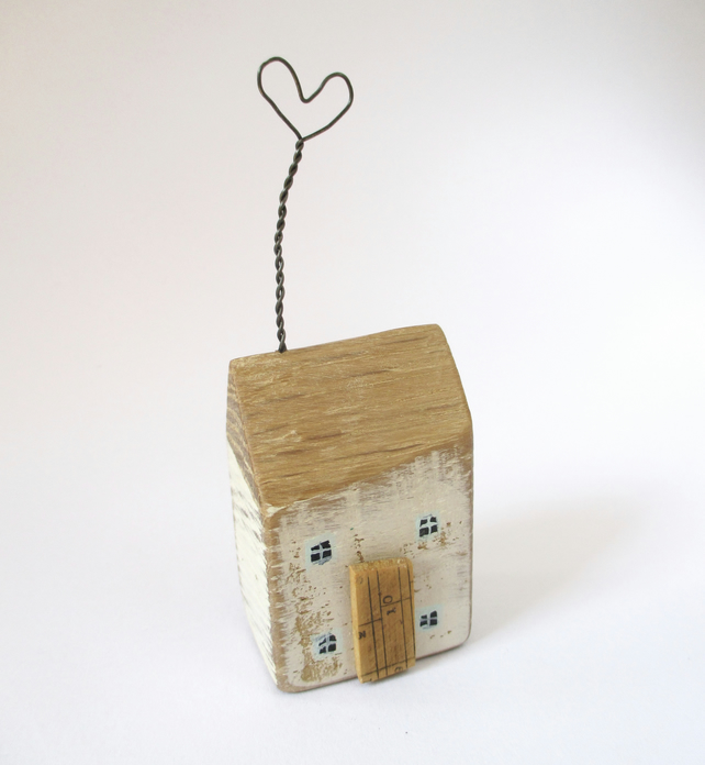 Little wooden house with a twisted wire heart