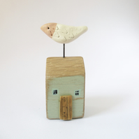 Little wooden house with a clay bird