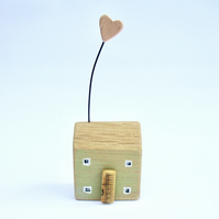 Little wooden house with a clay heart