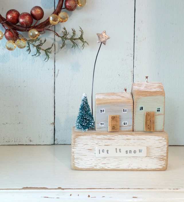 Little wooden terrace with Christmas tree and star