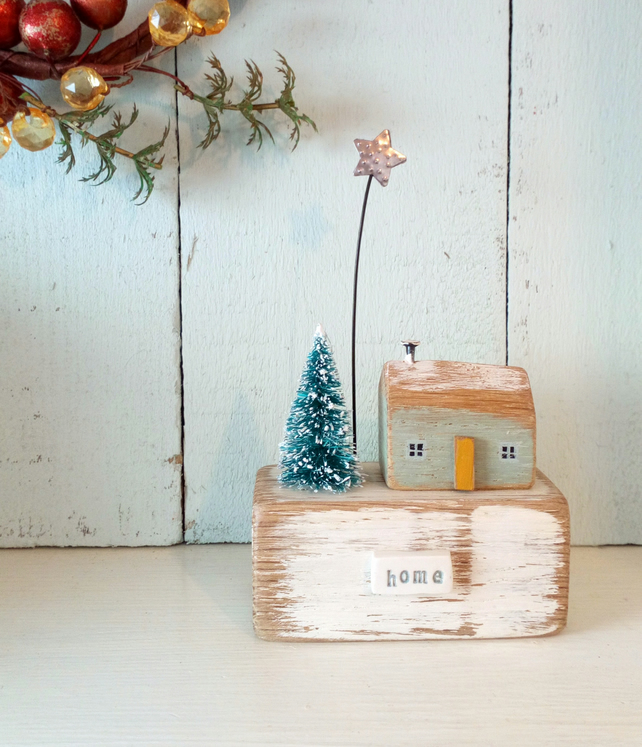 Little wooden house with Christmas tree and star