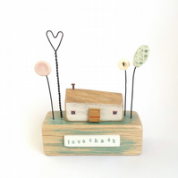 Little wooden loveshack with wire heart and flowers