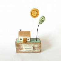 Little wooden house with sunflower garden