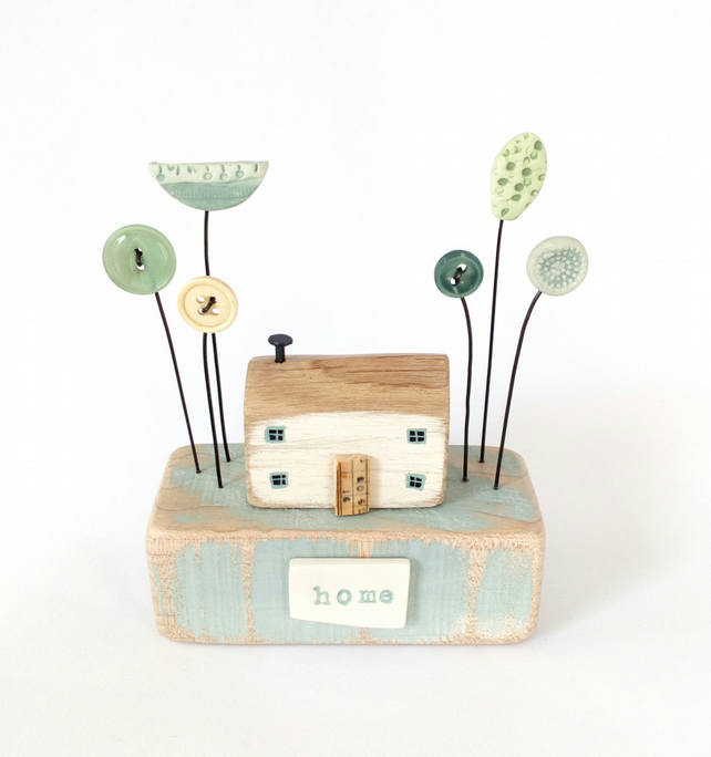 Wooden painted cottage with button and and clay flowers 'home'