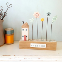 Little wooden house with clay and button flower garden 'sunshine'
