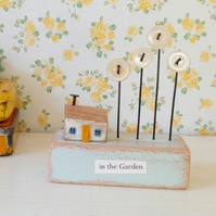 SALE - Little wooden house with button flower garden