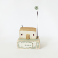 Little wooden house with flower 'home'