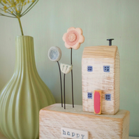 Wooden house with clay flower garden 'happy home'