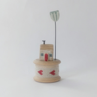 Tiny oak house on vintage bobbin with clay flower