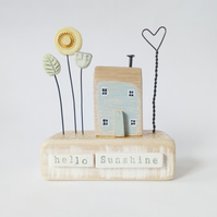 Little wooden house with sunflower garden 'hello sunshine'