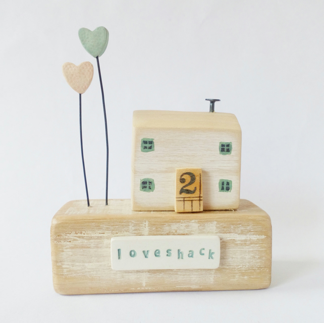 Wooden house with two clay hearts 'loveshack'