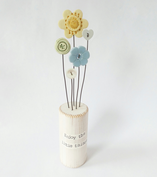Clay and button flowers in a painted block 'Enjoy the little things'