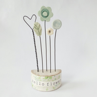 Clay and button flowers in a floral wooden block 'hello flower'