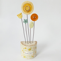 Clay and button flowers in a floral wooden block 'hello'