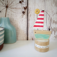 Handmade little wooden sail boat with sunshine button 'The sea is calling'