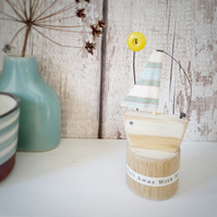 Handmade little wooden sail boat with sunshine button 'Sail away with me'