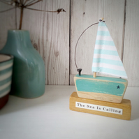 Handmade little wooden sail boat 'The Sea is Calling'