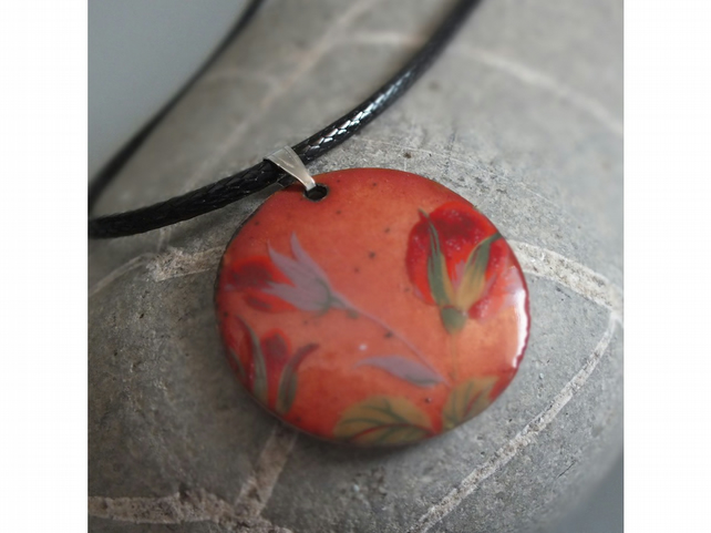 Floral, copper coloured enamel pendant